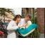 fullscreen_retina_portrait-mc8557_2020_maxicosi_carseat_coral_lifestyle_summer_familycarryingbabyoutsidecuddling_landscape_rgb.jpg